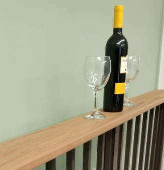 Image of Beverage Bottle With Two Glass on Beverage Railing